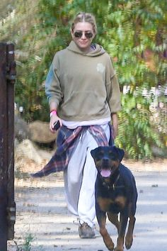 Ashley Olsen was recently spotted working out in Los Angeles with her friend Hayden Slater. Get her layered workout-ready look for fall with aviator sunglasses, a neutral hoodie, plaid shirt tied at the waist, grey sweatpants, and black sneakers.