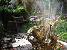 An Orchestral Water Fountain made of Brass instruments and a Piano Waterfall.  How beautiful is this !!! Not practical for my yard but wanted to share this work of art