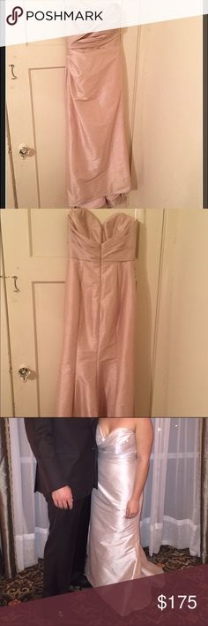 Formal dress/gown Only worn once as a bridesmaid gown in plantation wedding. Size 10 and altered to fit while worn with flats. It was a beautiful light pink/shiny champagne colored dress worn all night and very comfortable. It is somewhat structured and has padding. I am about 5'3 and normally wear size 6 jeans, small-medium tops, and about 36C cup size. From being outside, there is slight brown discoloration on the train but not terribly noticeable and have not attempted to remove it. Price…