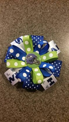 Hey, I found this really awesome Etsy listing at https://www.etsy.com/listing/218547319/seattle-seahawks-hairbow-or-headband-2