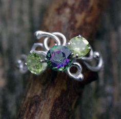 The Alice ring. First in my Alice in Wonderland line. Twisted wire, peridot, and mystic topaz.