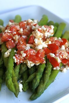 Asparagus with Tomatoes and Feta  This will be a regular in the rotation when aspargus comes into season again.