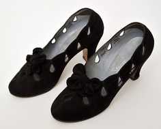 Women's Shoes  Black suede with black suede bow Size: Length: 21 cm; Height of heel: 7.5cm  Artist / Maker: Stacey  Place: England  Object Type: shoe  Actual Date: c.1935  Century: 20th century  Material: Suede