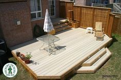 This 300 square ft bi level deck was constructed with Nexwood and cedar. The privacy screen and the trim are all cedar while the deck boards are low maintenance Nexwood. The project is located in Oakville. Low Deck Designs, Two Level Deck, Deck Steps, Deck Landscaping, Patio Enclosures, My Ideal Home, Diy Deck, Deck Plans, Building A Deck