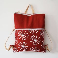 Backpack with double pocket red fabric printed by hand with