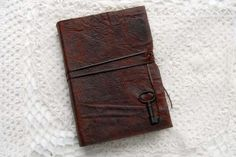 Tea stained leather book from bibliographica Antique Keys, Tea Stains, Leather Books, Wooden Beads, Brown Leather, Buy And Sell, My Love, Crafts, Stuff To Buy