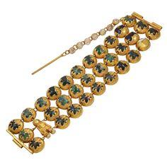 """LINE VAUTRIN Le Petit Poucet Bracelet  France  ca. 1946  """"Tom Thumb""""  A rare bronze doré and enamel bracelet"""