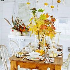 White dishes allow this easy fall branch DIY centerpiece to pop!