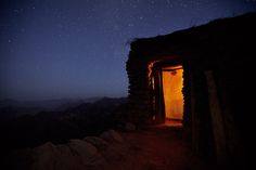 Rural house and mountain range . Tigray, Ethiopia by Mitchell Kanashkevich