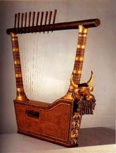 The Royal lyre: Several lyres were found in the Royal Tombs of Ur, along with the bodies of the women who played them.  Woolley reports that one woman lay with her arm draped across her lyre, with the bones of her hand where the strings had been, as if playing it.