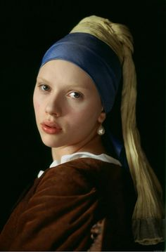 THE GIRL WITH THE PEARL EARRING. (2003)  Scarlett Johansson replicates the beautiful painting by Johannes Vermeer.  This speculative account of the life of Griet, a 16-year-old girl who appears in Johannes Vermeer's painting of the same title. Set in 17th century Holland, Griet is employed by Vermeer as a housemaid to care for his six children & his jealous pregnant wife. Tensions arise when Vermeer's wife suspects intimacy between her husband & the girl.