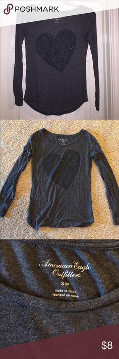 American Eagle Shirt Black and grey long sleeve American Eagle Outfitters shirt. This shirt is a size small, and it has a cute, sparkly heart in the middle of the shirt. It is made out of a soft and stretchy material. This shirt has been worn before, but it is in great condition. American Eagle Outfitters Tops Tees - Long Sleeve