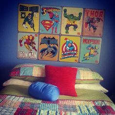 A retro Super Heroes Legends room for my lil L! Tin signs (as headboard) from RetroPlanet.com and bedding from Overstock. Color pallet: red, blue and lime.