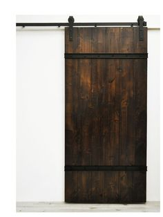 The Drawbridge Barn Door features sturdy wood planks lightly distressed and bolted together with metal plating. This sliding door style is well suited for rustic spaces, but also fits in modern applic Decor, Doors, Barn, Door Design, Wood Doors Interior, Rustic Space, Home Decor, Barn Doors Sliding, Doors Interior
