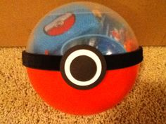 Pokeball party favors for my sons 8th Birthday party.  Found the orb at Party City for $.99.  Used black ribbon around the orb and then 3 circle punches to make the button.  I also used 3D pop dots for the circles