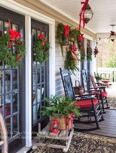 Wreaths on Window Panes And Walls OF Patio With Red Ribbons