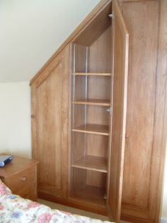 build custom doors on closet to make use of sloped spaces