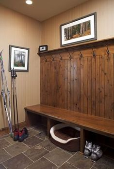 Mud room-- I want one really long bench just like this for the front downstairs hallway. I just need someone to help me build a bench, get some bead board, and some cheap hooks!!