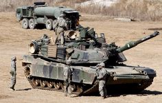 US Army soldiers and M1A2 tanks participate in the South Korea-US 'Foal Eagle' annual joint military exercises at the Mugeon-ri drill field on Paju, Gyeonggi-do, South Korea, 10 March 2014. South Korean and US military Combined Forces Command are holding the annual Foal Eagle exercise with 7,500 US servicemen involved.