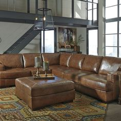 That Furniture Outlet - Minnesota's #1 Furniture Outlet. We have exceptionally low everyday prices in a very relaxed shopping atmosphere. Ashley Vincenzo Nutmeg 3 Piece Leather Sectional thatfurnitureoutlet.com #thatfurnitureoutlet  #thatfurniture  High Quality. Terrific Selection. Exceptional Prices.