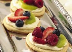 Mini Fruit Pizzas! -- Okay for the fun part.. FRUIT PIZZA BAR! Have all the toppings set up so guests can make their own mini Fruit Pizzas with their own personal touch!