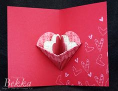 A pop out heart with three little heart shaped cards inside