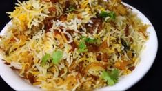 Chicken Biryani Recipe Chicken Biryani is a delicious savory rice dish that's loaded with spicy marinated chicken, caramelized onions, and flavorful saffron rice. Indian Chicken Recipes, Veg Recipes, Spicy Recipes, Curry Recipes, Indian Food Recipes, Healthy Dinner Recipes, Cooking Recipes, Pakistani Food Recipes, Mexican Rice Recipes