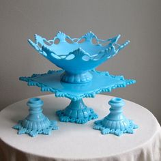 Blue Milk Glass Westmoreland: pierced bowl, cake stand, and candlesticks.
