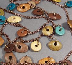 The colors in this necklace are beautiful! Earth tones paired with a touch of turquoise makes for a spectacular combination. The ceramic spacers