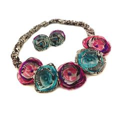 This lovely Bohemian flower necklace and earring set is sure to bring you compliments. This necklace and earring set would be a lovely addition to a Boho theme wedding outfit. Turquoise and pink water color like print fabric is mixed with brown and white tribal print fabrics to form 5