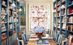 A panel of Braquenié's tree of life hangs in the couple's library-style dining room.