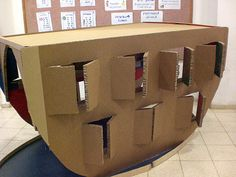 PRESCHOOL: Cardboard ark, cute! Inspires the idea of a ground-level wall cabinet unit, designed and decorated to look like an ark, with cabinet doors to hold a pair of various animals. The top of the cabinet would form a shelf, where more animals can be lined up, and a ragdoll of Noah and Mrs. Noah can sit.