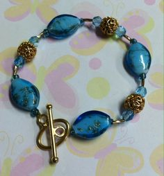 Sky Blue Bracelet Made with gold flakes in each glass bead & Czech crystals on stretch cord. $10.00