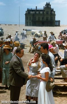 """Here is Rock Hudson on location in Marfa, Texas, for the overblown George Stevens movie """"Giant."""" Mercedes McCambridge and Elizabeth Taylor stand on either side of Hudson."""