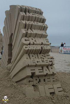 Esta es una obra de ingeniería, la tensión a la que está sometida fiu... HERMOSO!!  JPB: Sand Sculpture collection  | Lamb writing | Flickr - Photo Sharing!