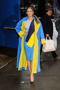 In a Roksanda color block dress, coat, and gold Louboutin heels out in New York City.