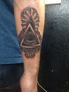 Traditional all seeing eye tattoo.