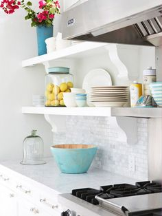 love the open shelves and mosaic tile backsplash in this white kitchen.  #interiors, #white, #kitchens
