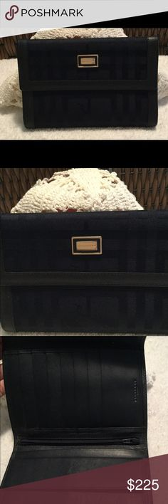 Burberry ladies navy wallet with leather trim Burberry ladies navy blue fabric patterned wallet with leather trim.  Interior has 7 credit card slots plus snap change area and zippered compartment - stunning!  Very gently used and cherished Burberry Bags Wallets