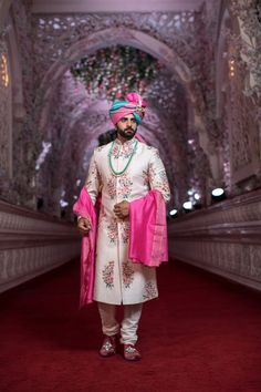 Looking for Pretty floral sherwani with pink and blue safa? Browse of latest bridal photos, lehenga & jewelry designs, decor ideas, etc. on WedMeGood Gallery. Engagement Dress For Groom, Couple Wedding Dress, Wedding Outfits For Groom, Groom Wedding Dress, Wedding Attire, Sherwani For Men Wedding, Wedding Dresses Men Indian, Sherwani Groom, Mens Sherwani