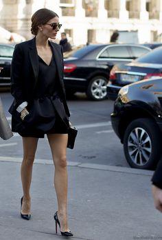 Black peplum blouse, black boyfriend blazer, black shorts, and pointed toe pumps.