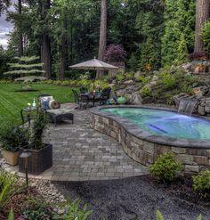 Waterfall into spa http://www.paradiserestored.com/portfolio/talwalker/