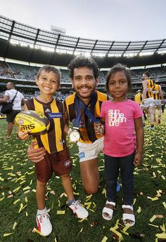 2015 Toyota AFL Grand Final - Hawthorn v West Coast - Hawthorn's Cyril Rioli poses for photos with his children