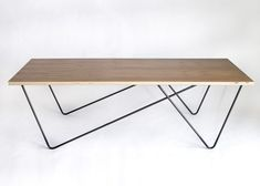 Twin Pin table by GrayInc. On the hunt for the coffee table. This one is great!