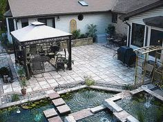 This patio was made by the homeowner with our inch Castle Stone steppingstone molds in his garage. The inch thick patio stones cost les than 75 cents a square foot in materials to make. See more photos and supplies at www. Flagstone Patio, Brick Patios, Concrete Patio, Backyard Patio, Backyard Landscaping, Concrete Molds, Concrete Stone, Concrete Projects, Concrete Countertops