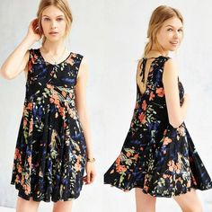 Urban Outfitters Ecote Clary Godet Trapeze Dress Breezy trapeze dress from boho brand Ecote in a short + swingy silhouette. Relaxed fit with a banded crew-neck and armholes finished with a deep scoop-back and tie closure at the rear neckline. Urban Outfitters Dresses Mini