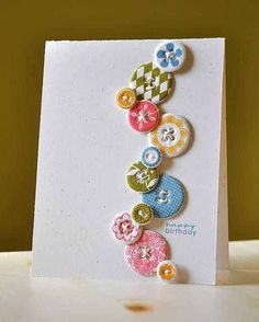 buttons in a random line, to mail, try punching from patterned cardstock