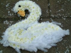 swan made of flowers and feathers
