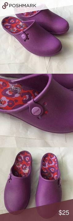 Croc's adorable purple! Croc's women's size 9! Love the purple! Slip on style! 1 inch slight wedge! New never worn! CROCS Shoes Mules & Clogs