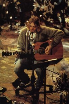 Kurt Cobain in his last official concert before his ill-timed death he'll always have a place in my heart <3